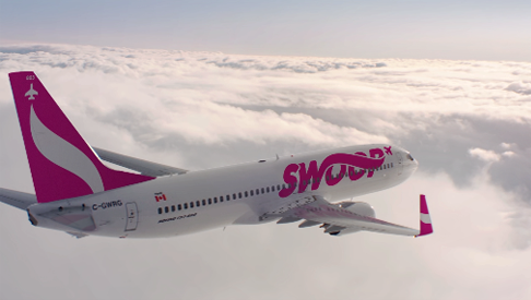 a picture of the swoop aircraft flying above the clouds
