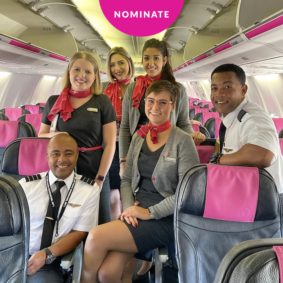 Swoop | flight attendants sitting on the plane
