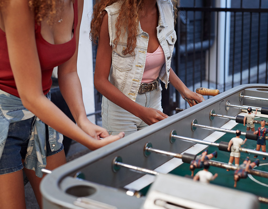 Swoop | picture of people playing foosball in Hamilton, Ontario