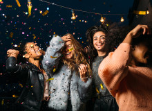image of four girls dancing with confetti
