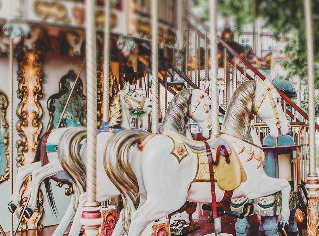 Swoop | a picture of a carousel horses at an Orlando theme park. Text