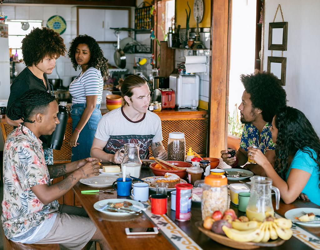 Swoop | a group of people eating in the kitchen together in Fort Lauderdale, Florida