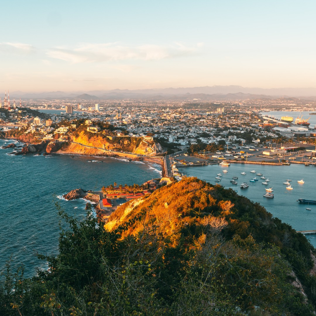 Swoop | a picture of mazatlan from el faro lighthouse during sunset in mexico