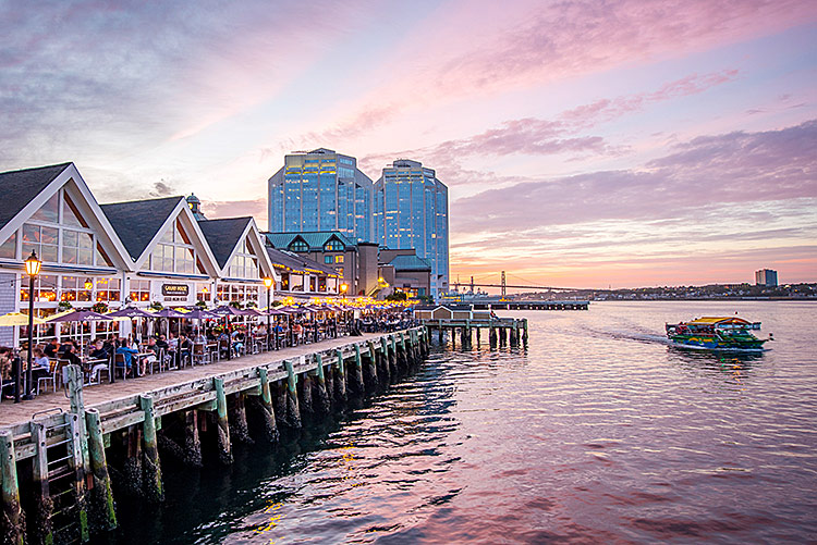 image of a boardwalk in Halifax during sunset.