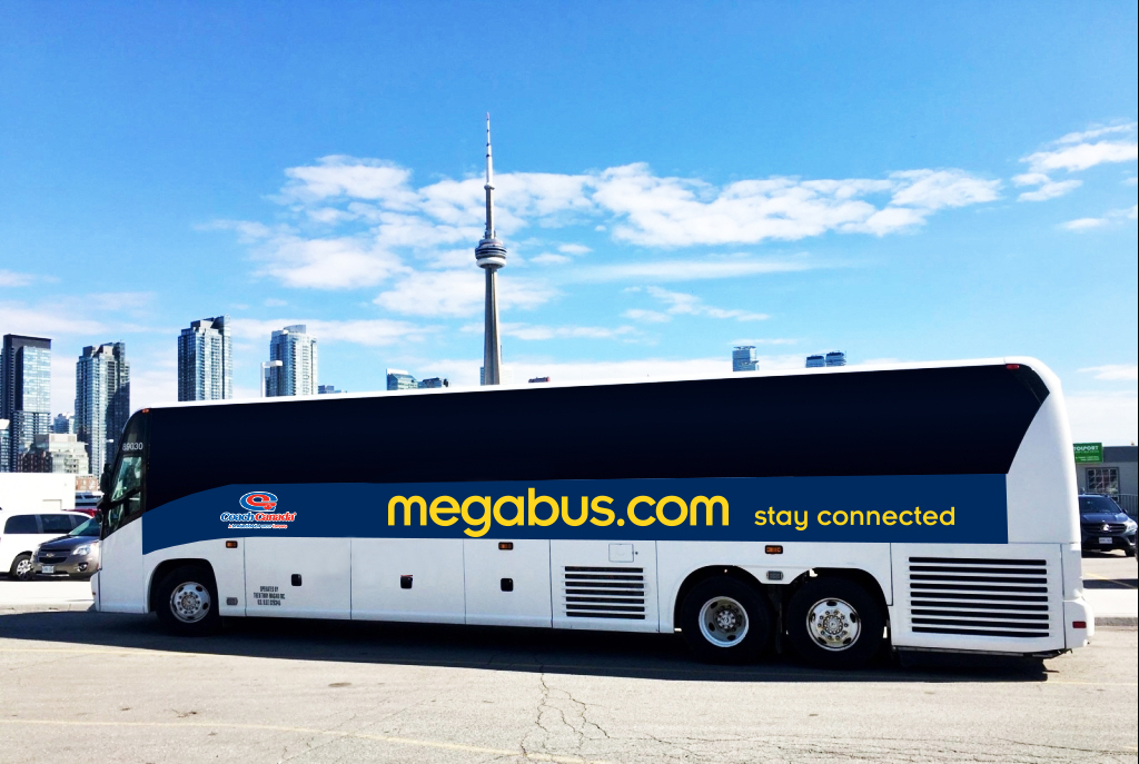 picture of a Megasbus bus in a parking lot in Toronto on a nice blue clear sky day