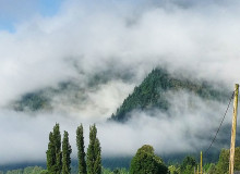Sumas mountain behind low hanging clouds in Abbotsford