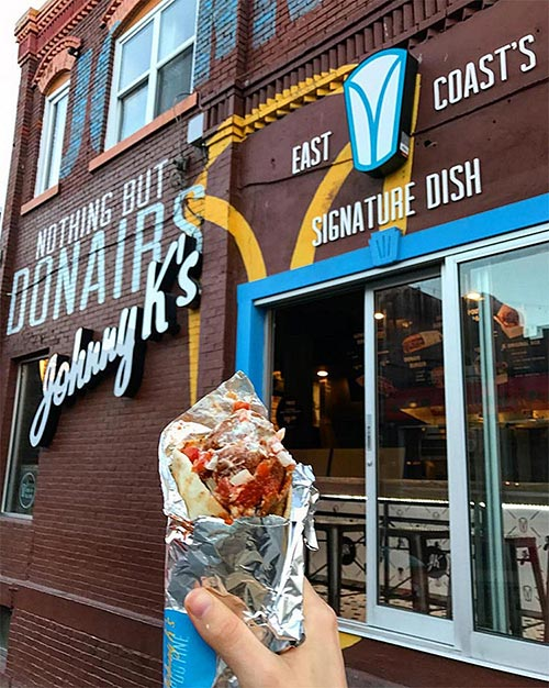 image of a donair in front of Nothing but donairs Johnny K sign.