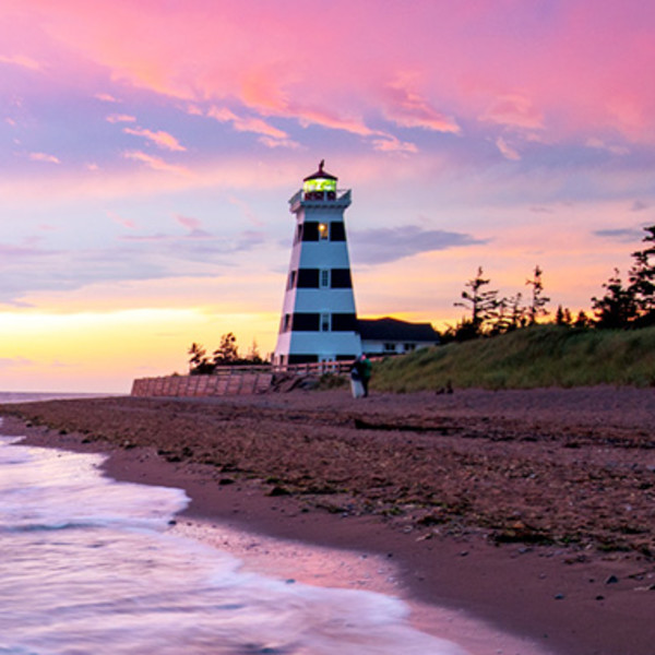 swoop | a picture of sunset at the lighthouse in charlottetown prince edward island