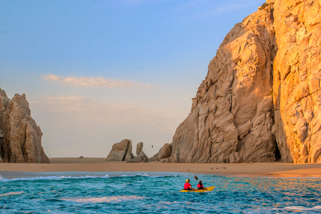 Swoop | a picture of Los Cabos, Mexico by the beach with two people in a kayak