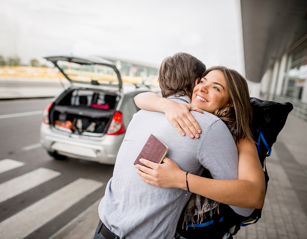 Swoop | two people hugging at the airport in Abbotsford British Columbia