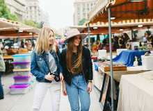 two girls walking in a flea market