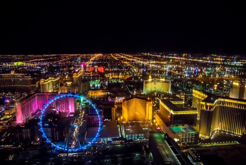 Swoop | an aerial image of las vegas with the high roller ferris wheel and the MGM hotel in view