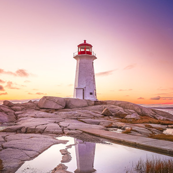 Swoop | a picture of the iconic Peggy Cove's lighthouse in Halifax during sunset
