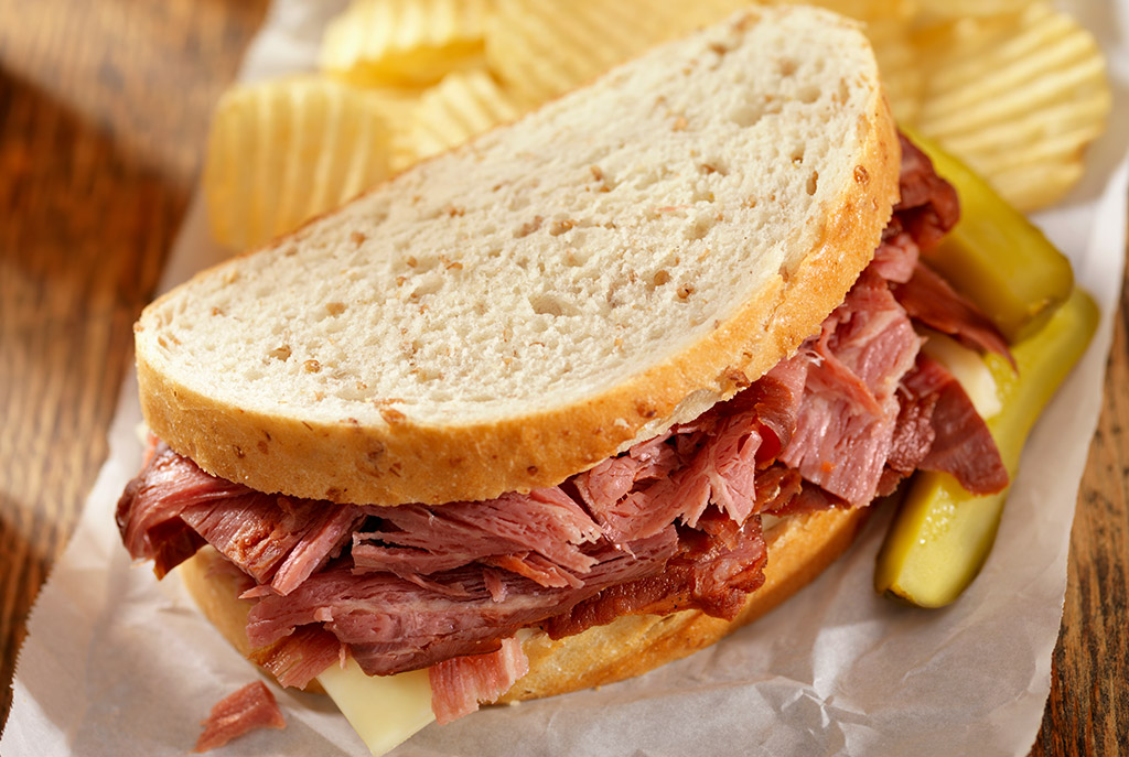 Swoop | a picture of a pastrami sandwich with pickles in Abbotsford