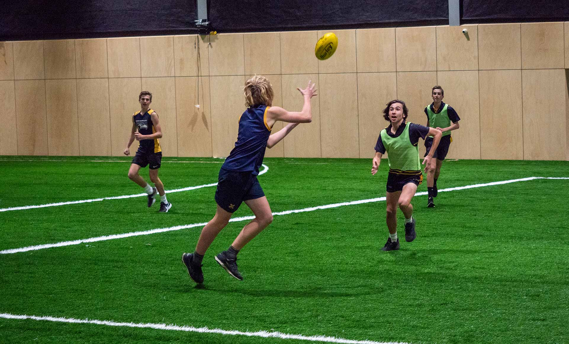 Kids playing footy at AFL Max indoor entertainment centre