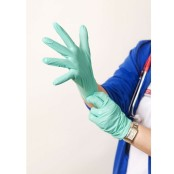 health care image of doctor pulling on latex gloves
