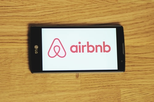 Airbnb logo on cellphone