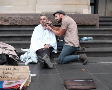 Josh Coombes is a hairdresser, community hero and movement maker. In 2015 he started to reach out to the homeless in his city and offer them free haircuts and started using the hashtag #DoSomethingForNothing. He passionately believes in giving dignity to the homeless and how pushing past stereotypes and preconceptions allows us to find real connections with people. This DoSomething movement was born from the idea that we are all able to do something for someone - for nothing. Today, Josh spends his time travelling to new countries to tell the stories of those who feel unheard.
