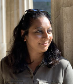 Raksha Dave is a Field Archaeologist, Public Archaeologist and Broadcaster.    In 1999, Raksha graduated from the UCL Institute of Archaeology, having already excavated on research projects in the UK, Puerto Rico and Texas. In 2000, she secured her first position as a commercial field archaeologist based in London where she worked predominantly on some of the capitals most iconic multi-period archaeological sites. During this time she worked on various research excavations around the world including the UNESCO World Heritage Site Catalhoyuk Research Project in Turkey.   With experience in the time periods spanning prehistoric to the Second World War, in 2003, Raksha was recruited by Channel Four's popular archaeology programme 'Time Team' – where she was a regular face on the show until its final episode in 2013. During her ten year stint on the show she excavated well over 100 sites including Westminster Abbey, Holyrood Palace, the D-Day defences and Normandy.   In between all of her time excavating, Raksha realised her passion for working with communities and the public whilst employed by a local authority in London; commissioning, developing and delivering public services in the education sector.  This is reflected in her later heritage work when she developed and managed various National Lottery Heritage funded community projects, sat on the board of trustees for the Council for British Archaeology (London) and became an advocate and patron for the Young Archaeologists Club.   She recently presented the BBC Learning Zone 'Ancient Voices' programme on Prehistory, Co-Presented 'Pompeii's Final Hours: New Evidence' for Channel 5 and 'Digging for Britain' - Series 7 for BBC 4. Raksha acts as an advocate and consultant for various arts organisations looking to broaden audience participation by looking at ways to encourage diversity and inclusivity in their environments.