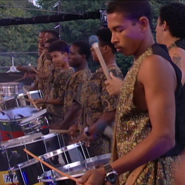 """Briz and Grupo Cultural OLODUM during the performance of """"The Obvious Child."""""""