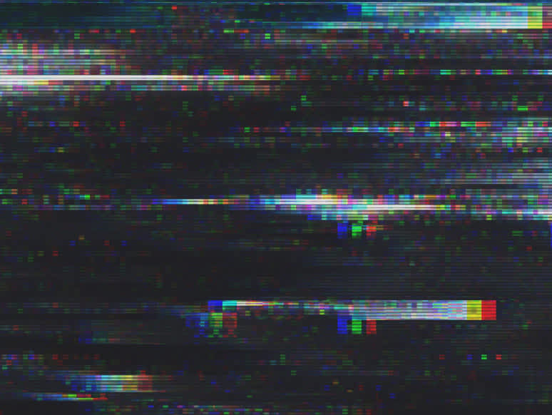 Black screen with white and rainbow static.