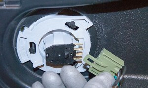 Connect the seat switch wire harness.
