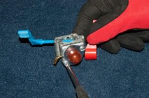 PHOTO: Remove the carburetor top cover screws.