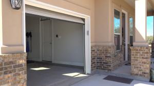 Installing a sensor sun shield on a garage door opener.