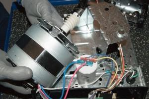 PHOTO: Reinstall the motor.