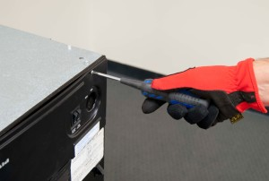 PHOTO: Remove the control panel screws.
