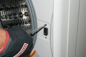 Reinstall the door lock mounting screws.