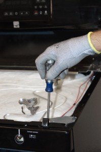 PHOTO: Remove the screws behind the clips on top of the control manifold.
