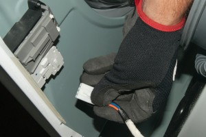 PHOTO: Plug in the door lock switch wire harness.