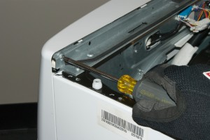 PHOTO: Remove the screw on the left back side of the control panel.