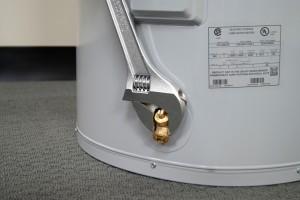 PHOTO: Remove the drain valve.