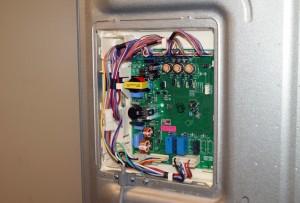 Remove the control board cover.