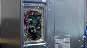 How to replace an electronic control board on the back of a refrigerator