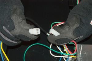 Unplug the fan control switch wire harness.