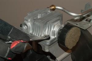 PHOTO: Remove the pump head bolts.