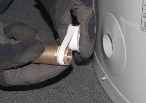 PHOTO: Apply thread sealing tape to the drain valve.