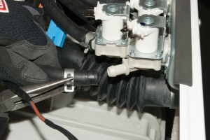 Pull the hoses off the water inlet valve.