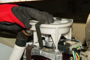 PHOTO: Remove the drain pump clips.
