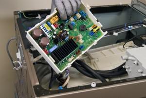 PHOTO: Remove the machine control board.