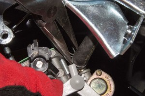 Connect the fuel line to the new carburetor.