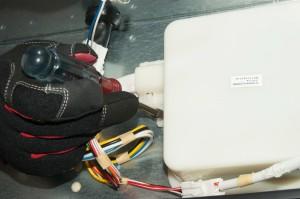 PHOTO: Remove the control board housing screw.
