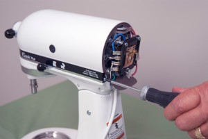 PHOTO: Remove the trim band screws.