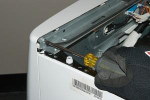 PHOTO: Reinstall the control panel rear screw.