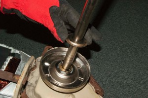 Remove the thrust washer from the transmission shaft.