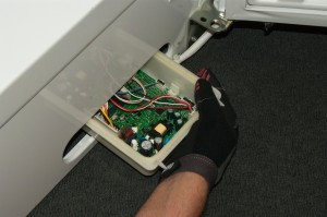 PHOTO: Connect the wires and push the control board into the cabinet.