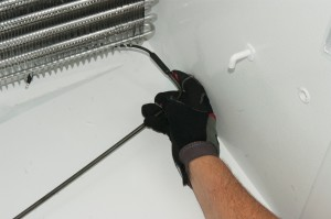 Push the new defrost heater into place.